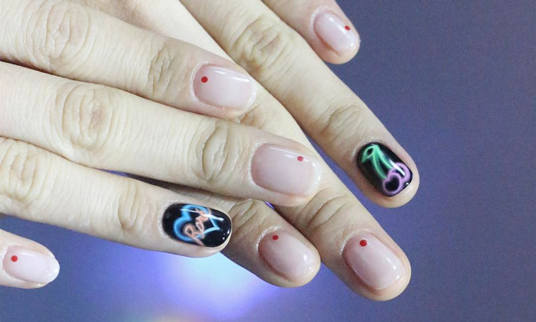 You\'re Going to See Neon Sign Nails Everywhere This Summer